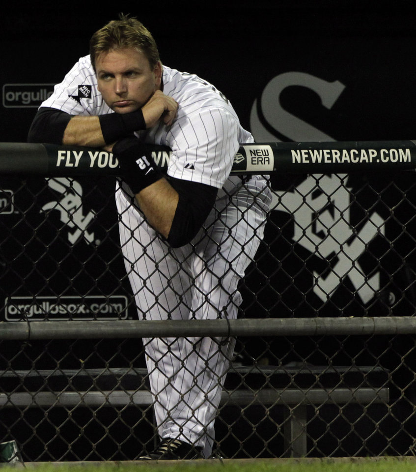 Photo -   Chicago White Sox's A.J. Pierzynski watches his team at bat during the ninth inning of a baseball game against the Minnesota Twins, Tuesday, Sept.4, 2012, in Chicago. The Twins beat the Sox 18-9. (AP Photo/John Smierciak)