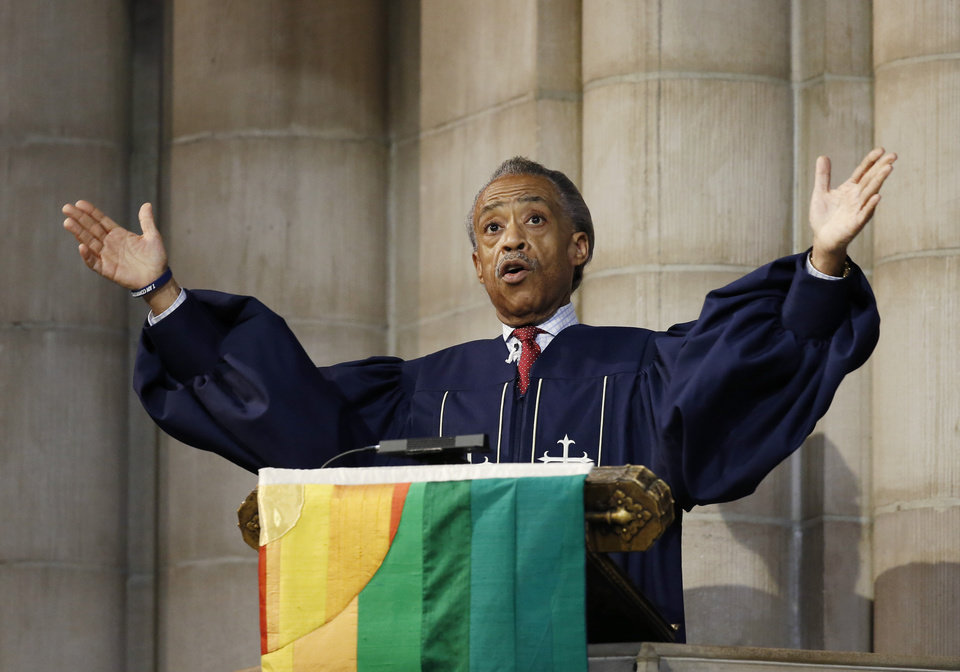 Photo - The Rev. Al Sharpton gestures as he addresses the congregation, Sunday, July 20, 2014, at Manhattan's Riverside Church in New York.  Sharpton demanded justice for the apparent police chokehold death of Eric Garner, who died three days ago in Staten Island.  He also said that citizens who kill police officers should be held accountable. (AP Photo/Kathy Willens)