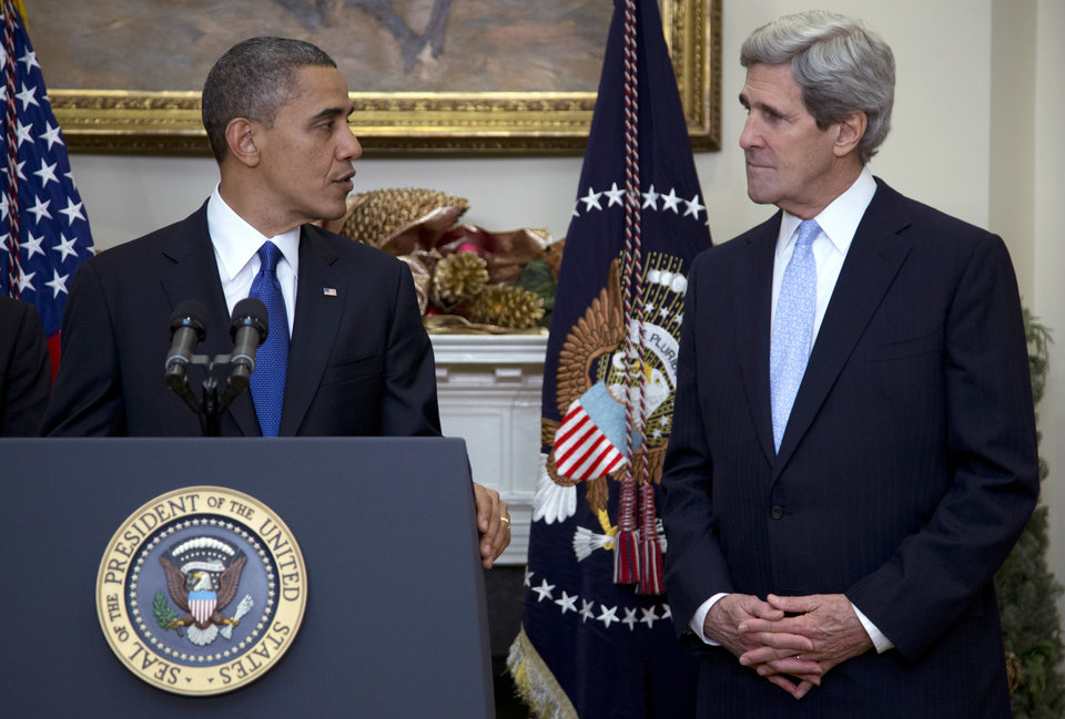 Photo - President Barack Obama looks to Sen. John Kerry, D-Mass., as he announces Kerry's  nomination for the next secretary of state in the Roosevelt Room of the White House, Friday, Dec. 21, 2012, in Washington. (AP Photo/Carolyn Kaster)