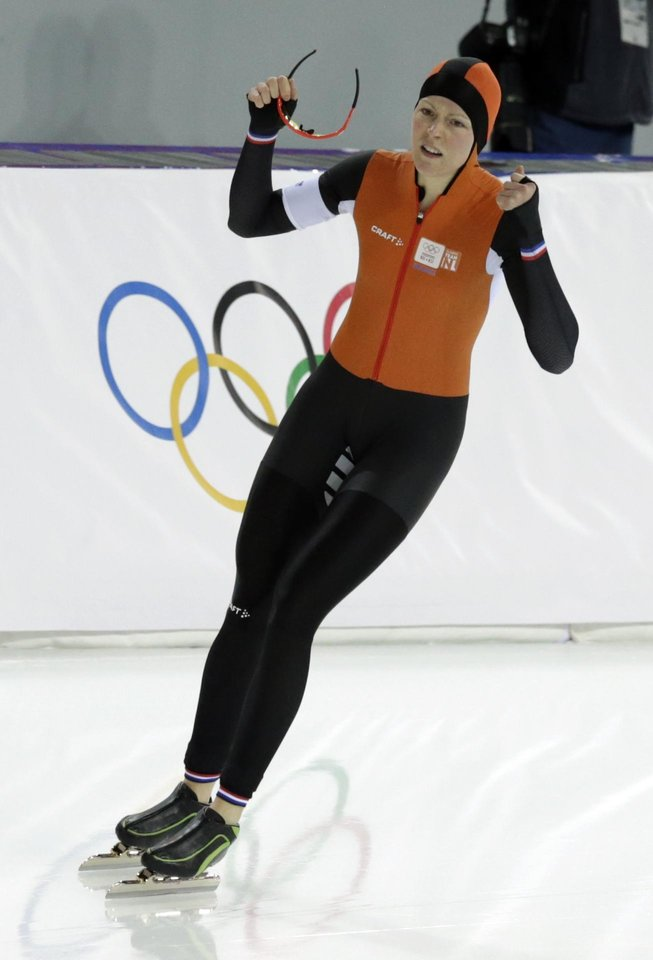 Photo - Jorien ter Mors of the Netherlands celebrates after seting a new Olympic record in the women's 1,500-meter race at the Adler Arena Skating Center during the 2014 Winter Olympics in Sochi, Russia, Sunday, Feb. 16, 2014. (AP Photo/Matt Dunham)