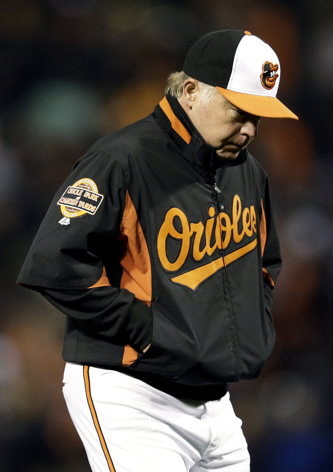 Baltimore Orioles manager Buck Showalter walks off the field after relieving starting pitcher Jason Hammel in the sixth inning of Game 1 of the American League division baseball series against the New York Yankees on Sunday, Oct. 7, 2012, in Baltimore. New York won 7-2. (AP Photo/Patrick Semansky)