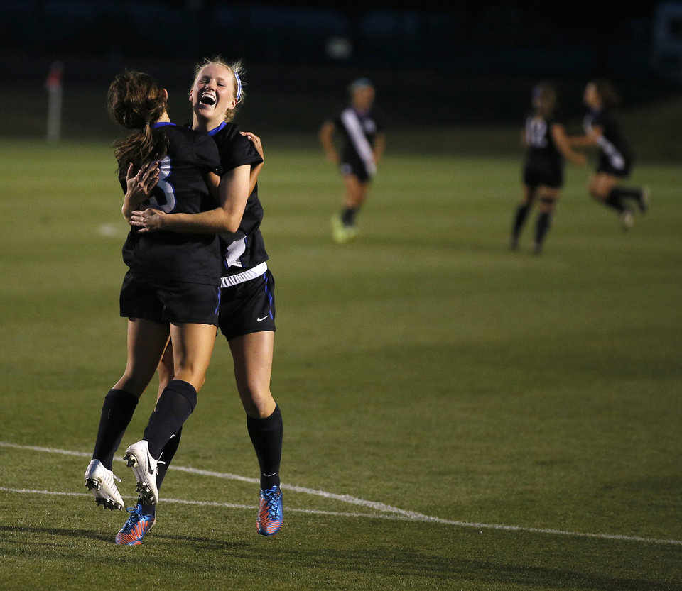 Photo - Deer Creek's Lauren Haivala and Rachel Mullen, at right, celebrate after Haivala scored a goal during the Class 5A girls state soccer championship between Deer Creek and Carl Albert in Norman, Okla., Saturday, May 17, 2014. Photo by Bryan Terry, The Oklahoman