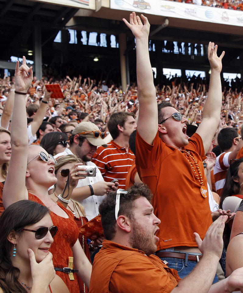 Texas fans celebrate during the Red River Rivalry college football game between the University of Oklahoma Sooners and the University of Texas Longhorns at the Cotton Bowl Stadium in Dallas, Saturday, Oct. 12, 2013. UT won, 36-20. Photo by Nate Billings, The Oklahoman