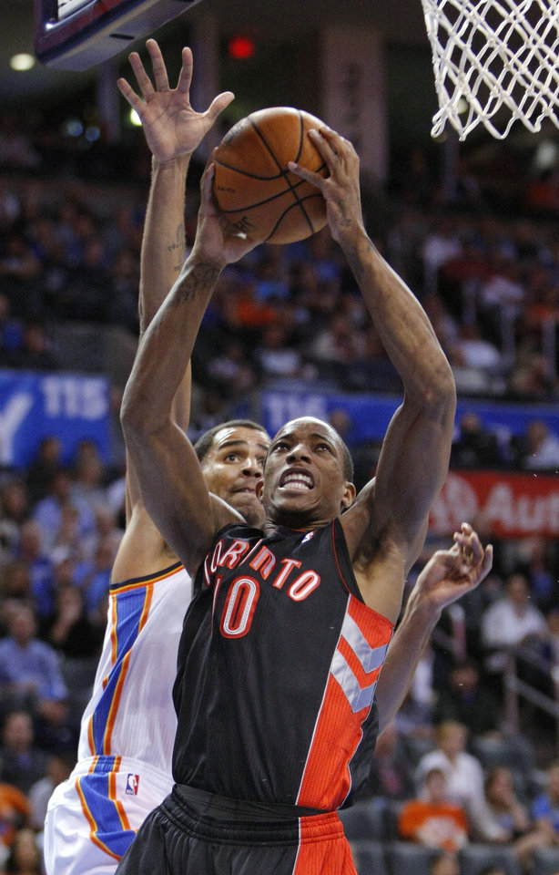 Photo -   Toronto Raptors guard DeMar DeRozan (10) goes up for a shot in front of Oklahoma City Thunder guard Thabo Sefolosha (2) during the first quarter of an NBA basketball game in Oklahoma City, Tuesday, Nov. 6, 2012. (AP Photo/Alonzo Adams)