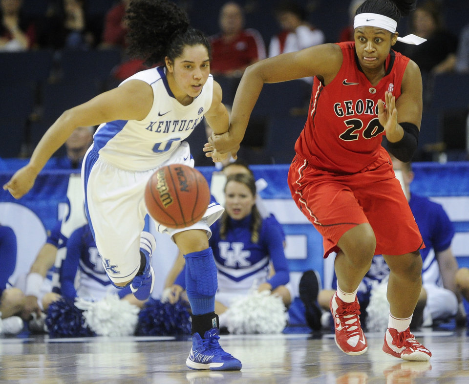 Photo - Kentucky guard Jennifer O'Neill (0) and Georgia guard Shacobia Barbee (20) race for a loose ball during the second half of an NCAA college basketball game in the Southeastern Conference tournament on Saturday, March 9, 2013, in Duluth, Ga. Kentucky won 60-38. (AP Photo/John Amis)