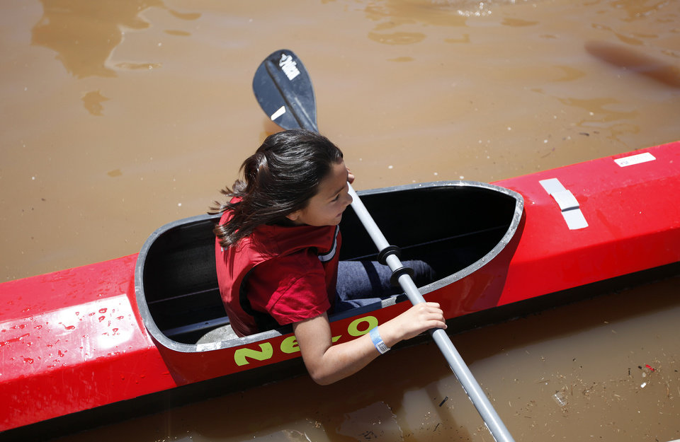 Kelly Woolum, 9, of Edmond, Okla., tries a kayak during the Paddle Now! Youth Experience on the Oklahoma River,  Saturday, April 21, 2012. Photo by Sarah Phipps, The Oklahoman.