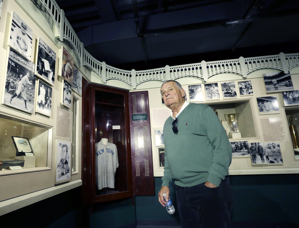 Photo - Former Atlanta Braves manager Bobby Cox visits a Babe Ruth exhibit during his orientation visit at the Baseball Hall of Fame on Monday, March 24, 2014, in Cooperstown, N.Y. Cox will be inducted to the hall in July. (AP Photo/Mike Groll)