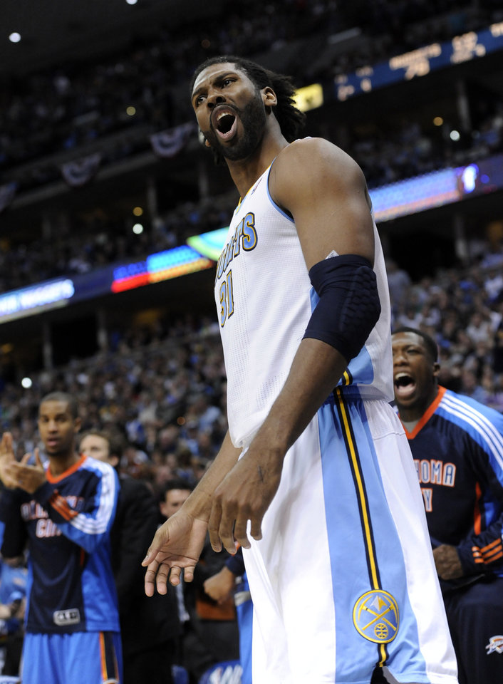 Photo - Denver Nuggets center Nene (31) from Brazil reacts during the second half of game 3 of a first-round NBA basketball playoff series against the Oklahoma City Thunder Saturday, April 23, 2011, in Denver. Oklahoma City beat Denver 97-94 to take a 3-0 series lead. (AP Photo/Jack Dempsey)