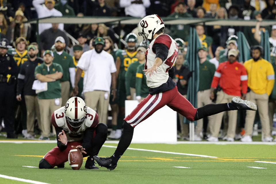 Photo - Oklahoma place kicker Gabe Brkic, right, kicks a 28-yard field goal as Connor McGinnis holds during the second half of an NCAA college football game against Baylor in Waco, Texas, Saturday, Nov. 16, 2019. (AP Photo/Ray Carlin)