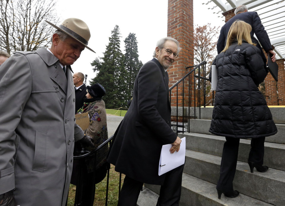 Photo -   Director Steven Spielberg, center, arrives at a ceremony to mark the 149th anniversary of President Abraham Lincoln's delivery of the Gettysburg Address at Soldier's National Cemetery in Gettysburg, Pa., Monday, Nov. 19, 2012. Walking behind Spielberg is Bob Kirby, Superintendent of Gettysburg National Military Park. Spielberg and historian Doris Kearns Goodwin delivered remarks and participated in a wreath-laying ceremony. (AP Photo/Patrick Semansky)