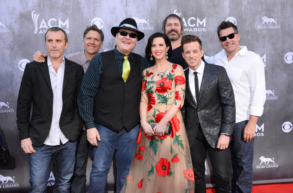 Photo - Fourth from right, Shawna Thompson and second from right, Keifer Thompson, of the musical group Thompson Square with the musical group Blues Traveler arrive at the 49th annual Academy of Country Music Awards at the MGM Grand Garden Arena on Sunday, April 6, 2014, in Las Vegas. (Photo by Al Powers/Powers Imagery/Invision/AP)