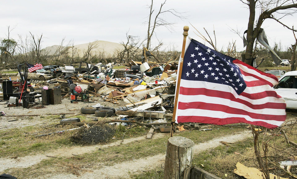 Flags fly at a tornado damaged home in Picher in this picture from May 13. Unlike most storms, no government money was awarded for rebuilding any of the 100 homes leveled by the deadly tornado. AP ARCHIVE