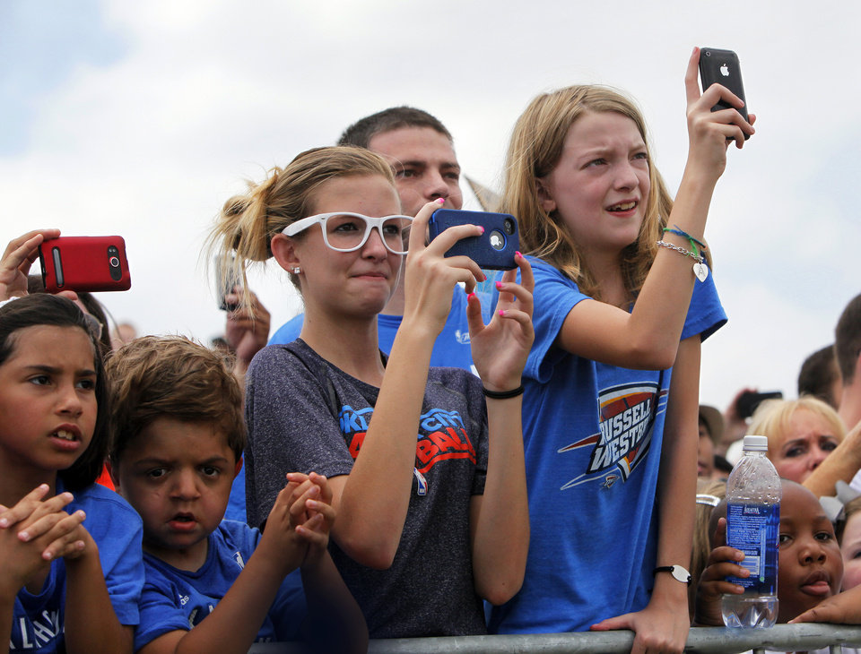 Photo - Fans wait for the team to arrive during a welcome home rally for the Oklahoma City Thunder in a field at Will Rogers World Airport after the team's loss to the Miami Heat in the NBA Finals, Friday, June 22, 2012. Photo by Nate Billings, The Oklahoman