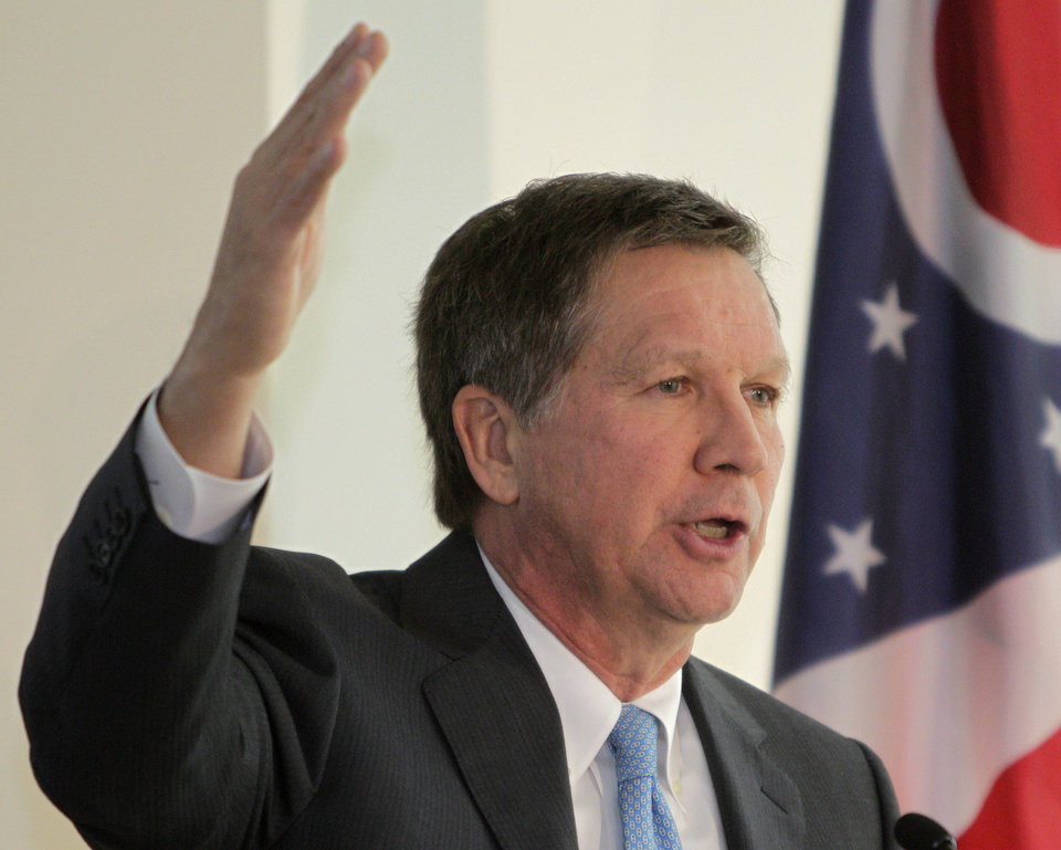Photo - Ohio Gov. John Kasich presents the fiscal year 2014-15 executive budget proposal during a news conference Monday, Feb. 4, 2013, in Columbus, Ohio. (AP Photo/Jay LaPrete)