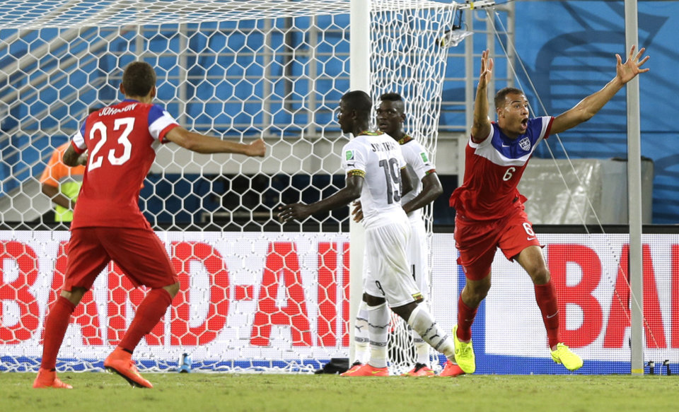 Photo - United States' John Brooks right, celebrates after scoring his side's second goal during the group G World Cup soccer match between Ghana and the United States at the Arena das Dunas in Natal, Brazil, Monday, June 16, 2014.   (AP Photo/Dolores Ochoa)