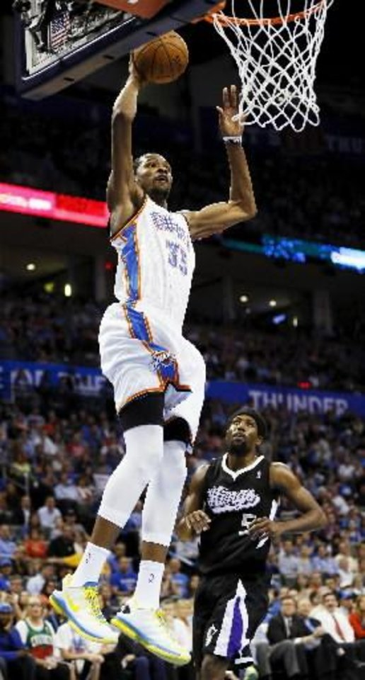 Oklahoma City\'s Kevin Durant (35) dunks in front of Sacramento\'s John Salmons (5) during an NBA basketball game between the Oklahoma City Thunder and the Sacramento Kings at Chesapeake Energy Arena in Oklahoma City, Monday, April 15, 2013. Photo by Nate Billings, The Oklahoman Archives