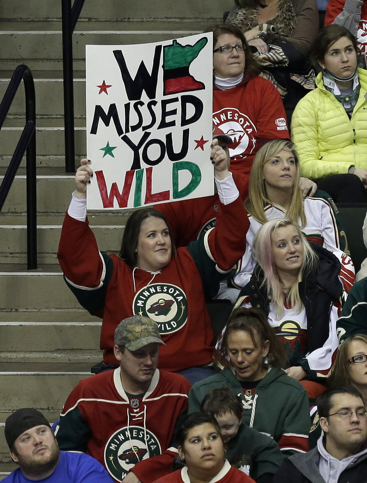 A Minnesota Wild NHL hockey fan holds up a sign as the Wild hosted the Colorado Avalanche in  an NHL hockey game Saturday, Jan. 19, 2013 in St. Paul, Minn., as the lockout shortened season got underway. (AP Photo/Jim Mone)