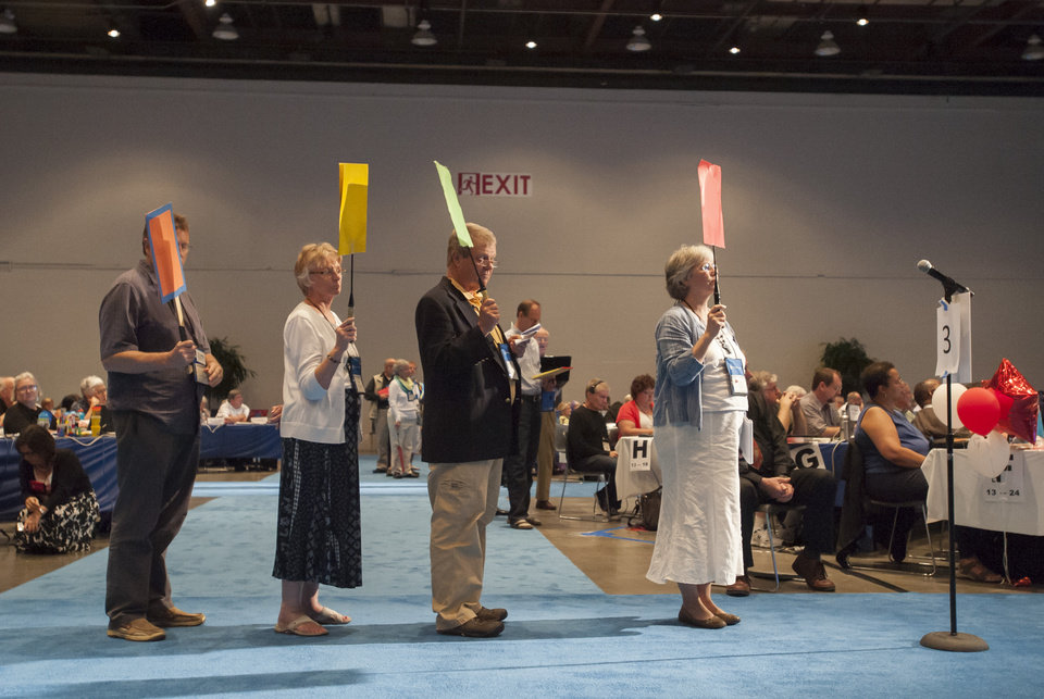 Photo - Commissioners and advisors wait in line to debate a vote on whether the church should recognize same-sex marriage at  the 221st General Assembly of the Presbyterian Church at Cobo Hall, in Detroit, Thursday, June 19, 2014. The top legislative body of the Presbyterian Church (U.S.A.) voted by large margins to recognize same-sex marriage as Christian in the church constitution, adding language that marriage can be the union of