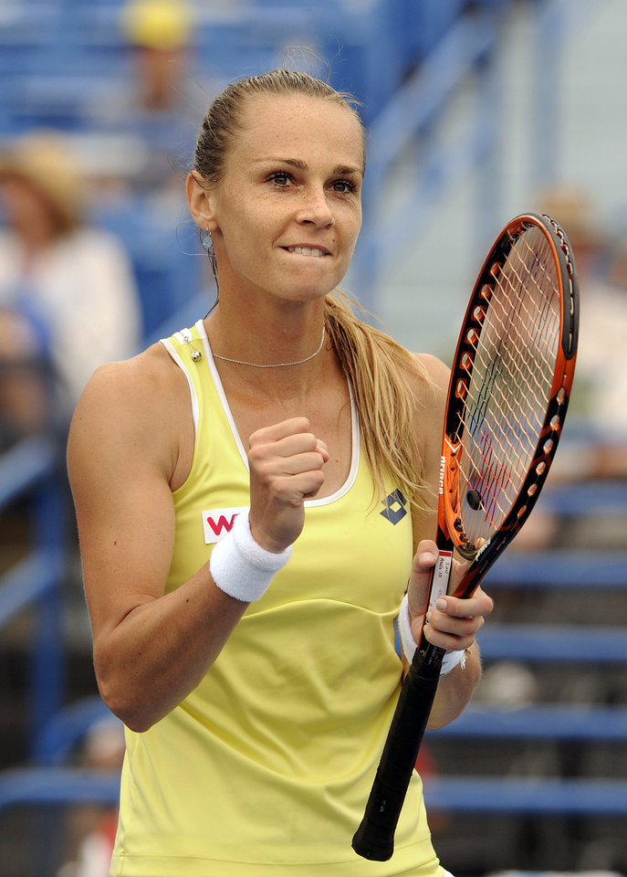 Photo - Magdalena Rybarikova, of Slovakia, celebrates after her 6-2, 6-4 semifinal victory over Camila Giorgi, of Italy, at the New Haven Open tennis tournament in New Haven, Conn., on Friday, Aug. 22, 2014. (AP Photo/Fred Beckham)