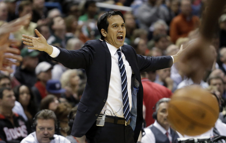 Photo - Miami Heat head coach Erik Spoelstra reacts during the second half of Game 3 in their first-round NBA basketball playoff series against the Milwaukee Bucks, Thursday, April 25, 2013, in Milwaukee. (AP Photo/Morry Gash)