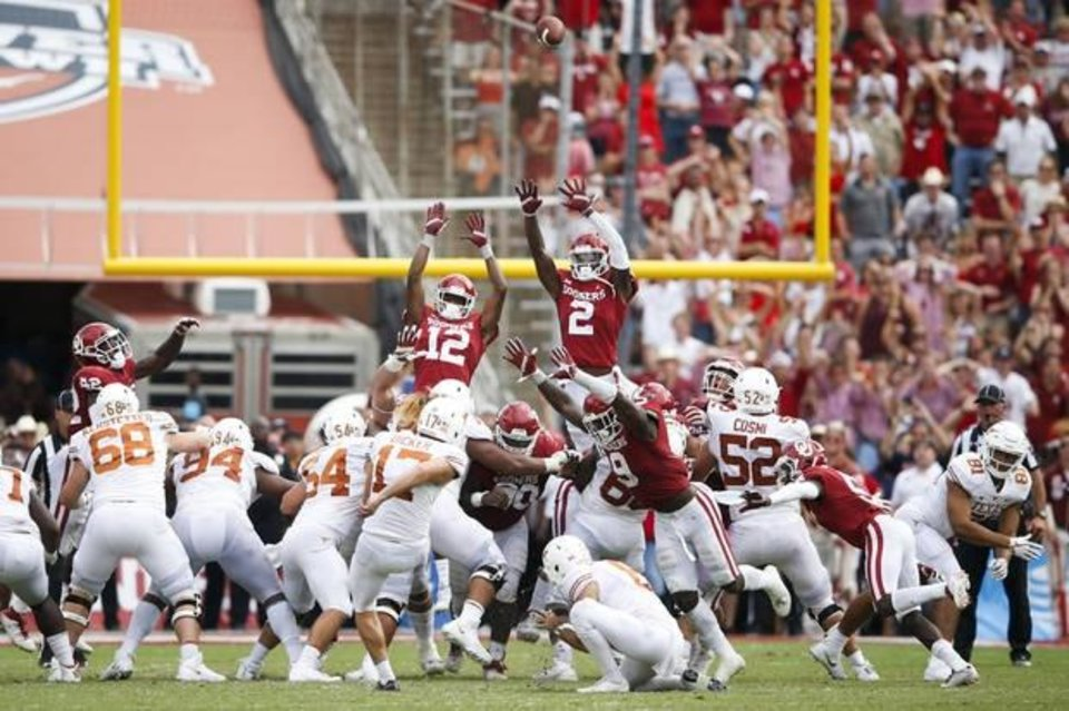 Photo - Oklahoma Sooners wide receiver A.D. Miller (12), Oklahoma Sooners wide receiver CeeDee Lamb (2) and Oklahoma Sooners linebacker Kenneth Murray (9) just miss blocking a go ahead field goal by Texas Longhorns place kicker Cameron Dicker (17) the Red River Showdown between the Texas Longhorns and the Oklahoma Sooners at Cotton Bowl Stadium on Saturday, October 06, 2018. IAN MAULE/Tulsa World