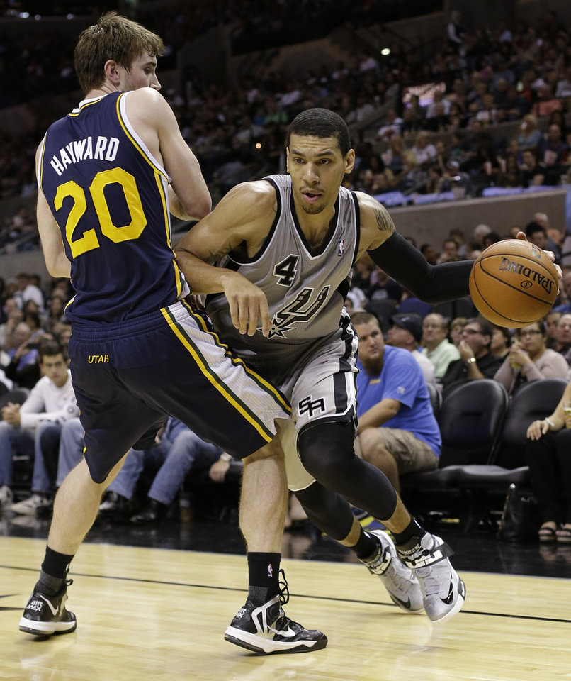 San Antonio Spurs' Danny Green (4) drives past Utah Jazz' Gordon Hayward (20) during the third quarter of an NBA basketball game, Saturday, Nov. 3, 2012, in San Antonio. (AP Photo/Eric Gay)