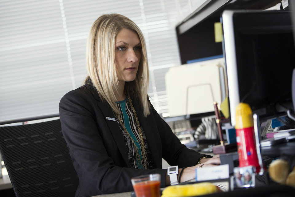 Photo -      Nida Degesys, National President of the American Medical Student Association, works at her office in Sterling, Va. Degesys graduated in May 2013 from Northeast Ohio Medical University with about $180,000 in loans. The amount has already swelled with interest to about $220,000. AP Photo   Evan Vucci -  AP