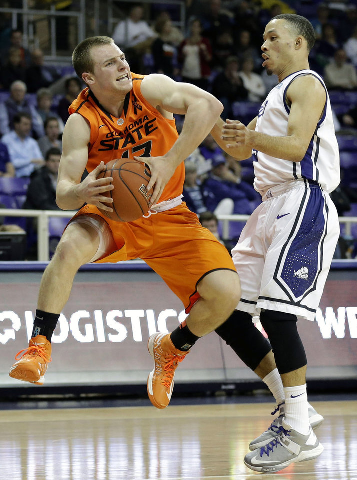 Oklahoma State's Phil Forte, left, has his drive to the basket disrupted by TCU 's Kyan Anderson (5) in the first half of an NCAA basketball game on Wednesday, Feb. 27, 2013, in Fort Worth, Texas. (AP Photo/Tony Gutierrez) ORG XMIT: TXTG105