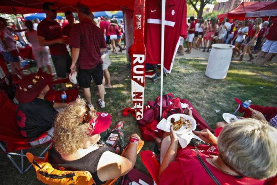 Photo - Sooner fans tailgate before the start of the football game between the University of Oklahoma Sooners and the University of Tulsa Hurricanes on Saturday at the Gaylord Family - Oklahoma Memorial Stadium in Norman.  CHRIS LANDSBERGER - CHRIS LANDSBERGER