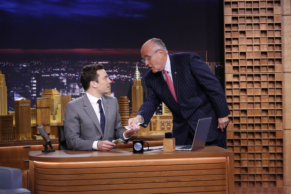 Photo - In this photo provided by NBC, Jimmy Fallon appears with former New York City Mayor Rudy Giuliani, right, during his