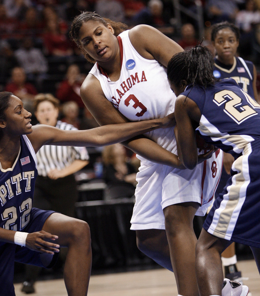Courtney Paris fights for a rebound with Chelsea Cole (22) and Sarah Agade (4) in the second half of the NCAA women's basketball tournament game between the University of Oklahoma and Pittsburgh at the Ford Center in Oklahoma City, Okla. on Sunday, March 29, 2009. 