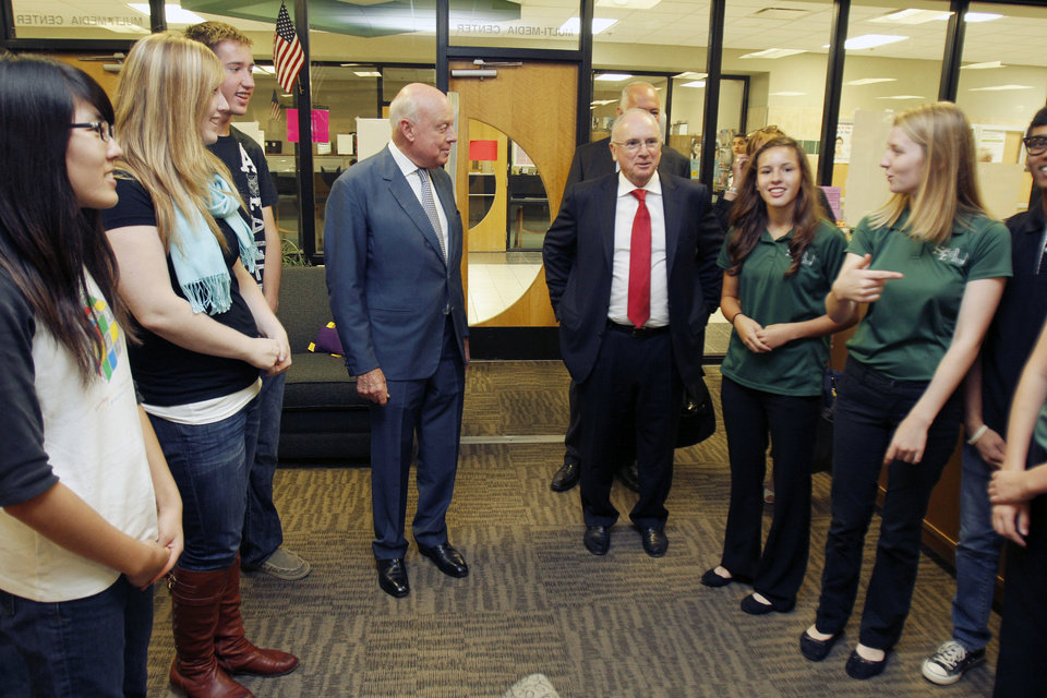 Queen Elizabeth II's representative, Roger Bramble, the deputy lieutenant of London, left, and Robert Bone, executive director of London's New Year's Day Parade and Festival, meet Edmond Santa Fe High School  students on Monday. Photos by Paul Hellstern, The Oklahoman