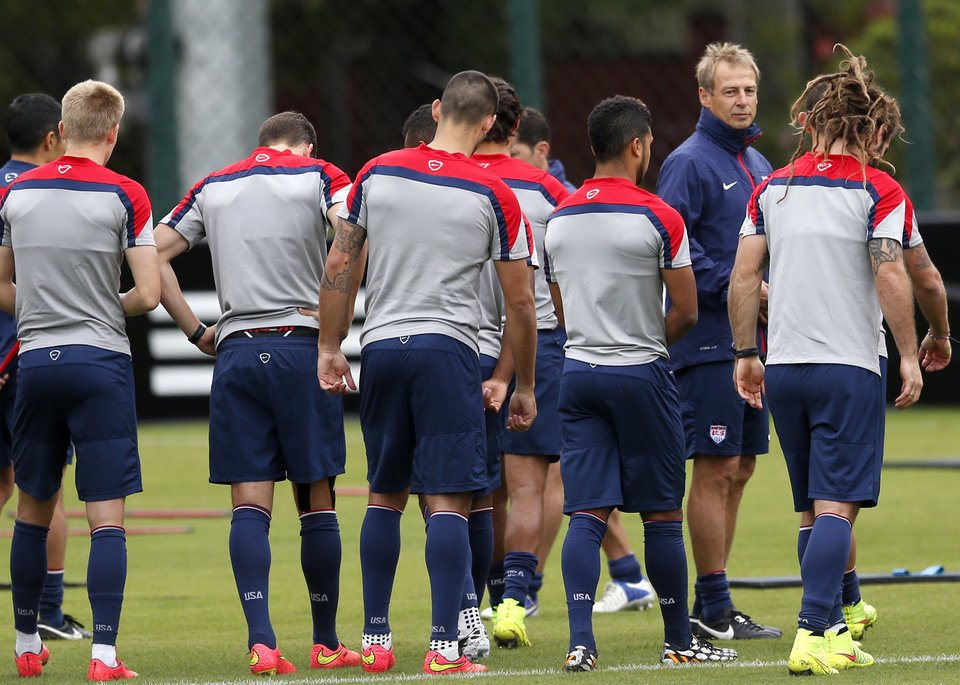 Photo - United States' head coach Jurgen Klinsmann stands with his team during a training session in Sao Paulo, Brazil, Thursday, June 19, 2014.  The United States will play against Portugal in group G of the 2014 soccer World Cup on June 22. (AP Photo/Julio Cortez)