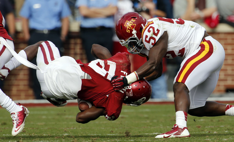 Iowa State Cyclone\'s Jeremiah George (52) brings down Oklahoma Sooner\'s Roy Finch (22) during the second half of the college football game between the University of Oklahoma Sooners (OU) and the Iowa State University Cyclones (ISU) at Gaylord Family-Oklahoma Memorial Stadium in Norman, Okla. on Saturday, Nov. 16, 2013. Photo by Steve Sisney, The Oklahoman