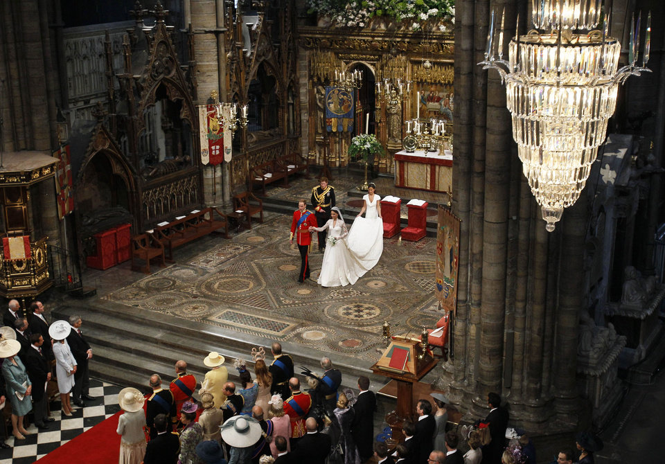 Photo - Britain's Prince William, center left, and his wife Kate, the Duchess of Cambridge, center right, Britain's Prince Harry, William's best man, back left, and maid of honour Philippa Middleton, back right, accompany them during their wedding service at Westminster Abbey in London, Friday, April 29, 2011. (AP Photo/Kirsty Wigglesworth, Pool)