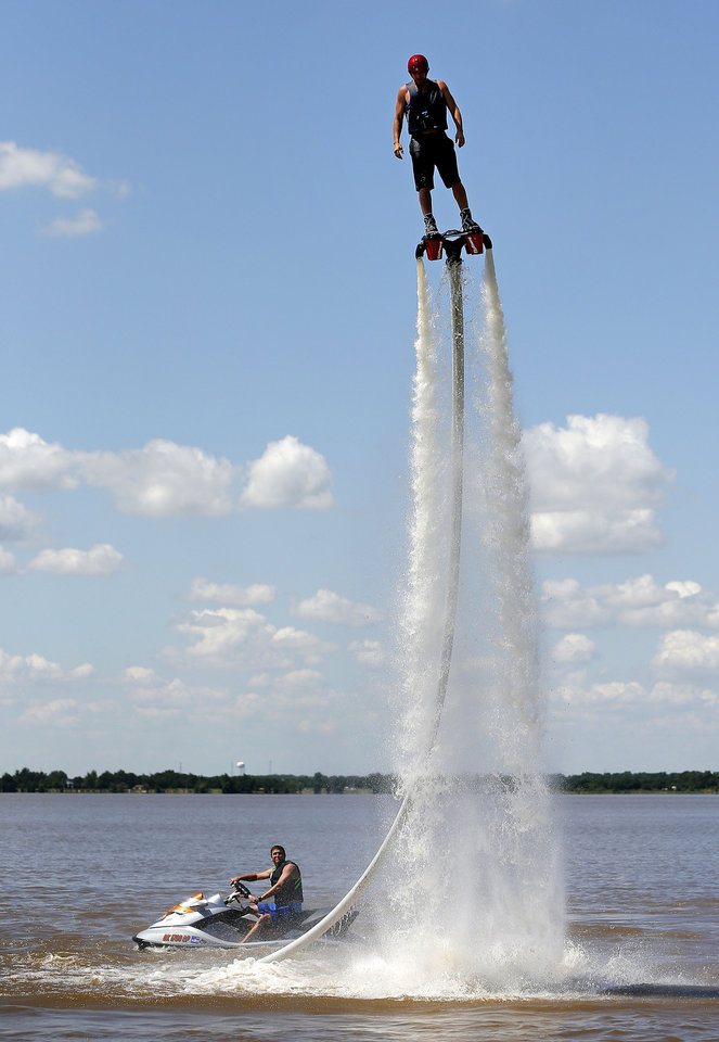 Jeff Luft, with Gulf State Flyboard,rides a Zapata Flyboard on Lake Overholser as Bobby Ecker controls the power from a personal watercraft Tuesday. Photo by Bryan Terry, The Oklahoman Bryan Terry - THE OKLAHOAMN