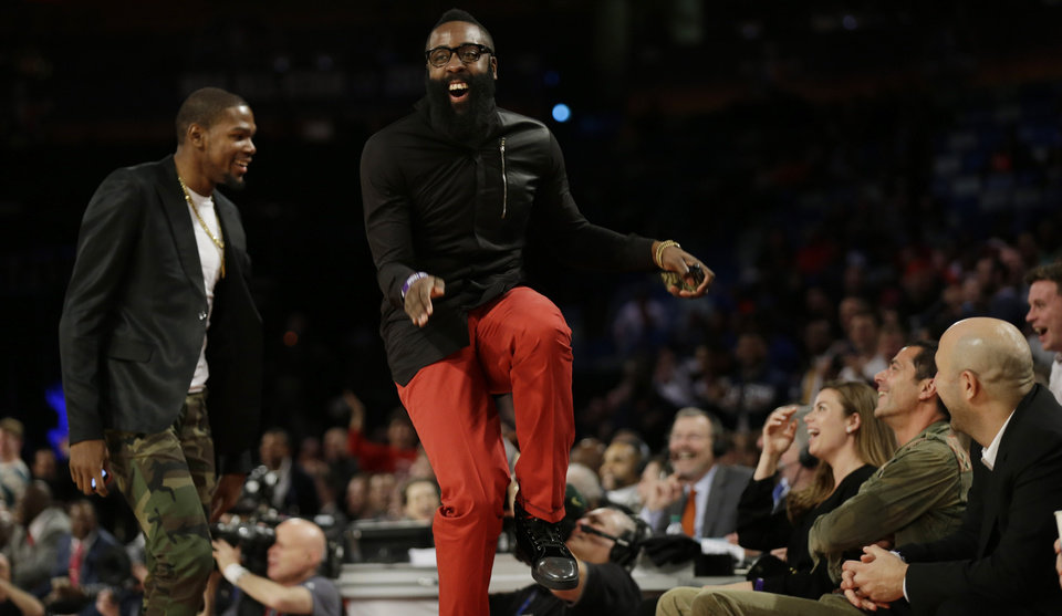Photo - Houston Rockets James Harden, right, dances with Oklahoma City Thunder Kevin Durant during the Rising Star NBA All Star Challenge Basketball game, Friday, Feb. 14, 2014, in New Orleans. (AP Photo/Gerald Herbert)