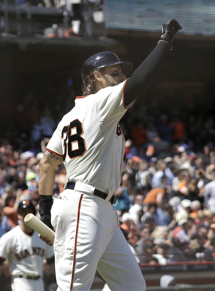 Photo - San Francisco Giants' Michael Morse celebrates after scoring on Gregor Blanco's base hit against the Washington Nationals during the sixth inning of a baseball game in San Francisco, Thursday, June 12, 2014. (AP Photo/Jeff Chiu)