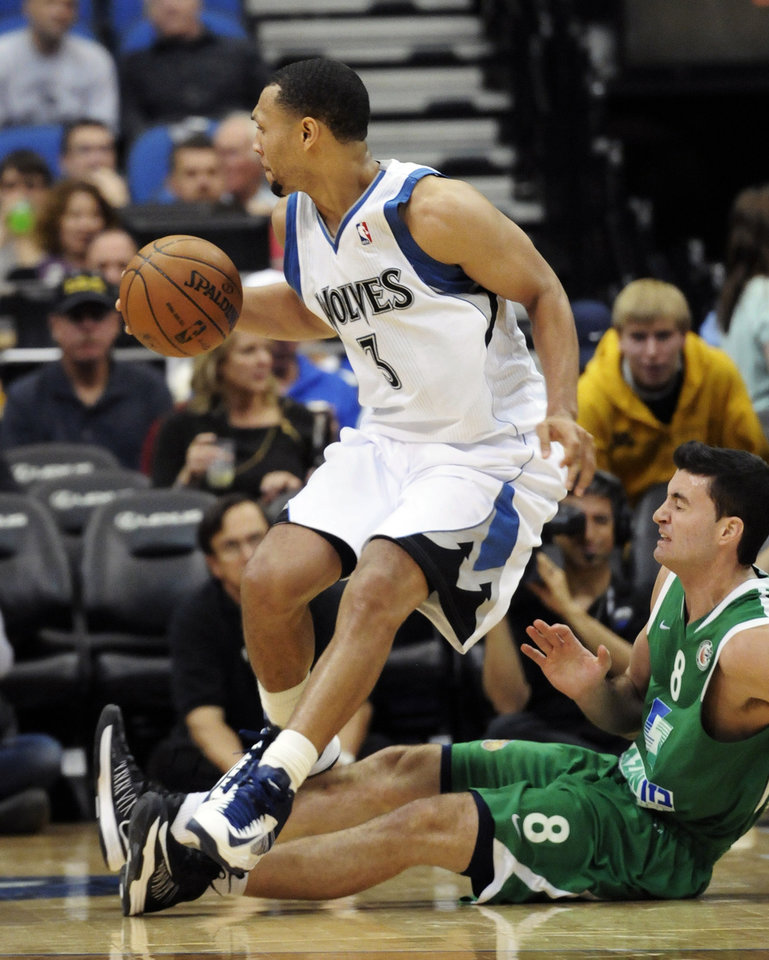 Photo -   Minnesota Timberwolves' Brandon Roy, left, leaves Maccabi Haifa's Bryan Cohen on the floor during the second half of an NBA exhibition basketball game against the Israeli team, Tuesday, Oct. 16, 2012, in Minneapolis. The Timberwolves won 114-81, with Roy scoring 19 points. (AP Photo/Jim Mone)