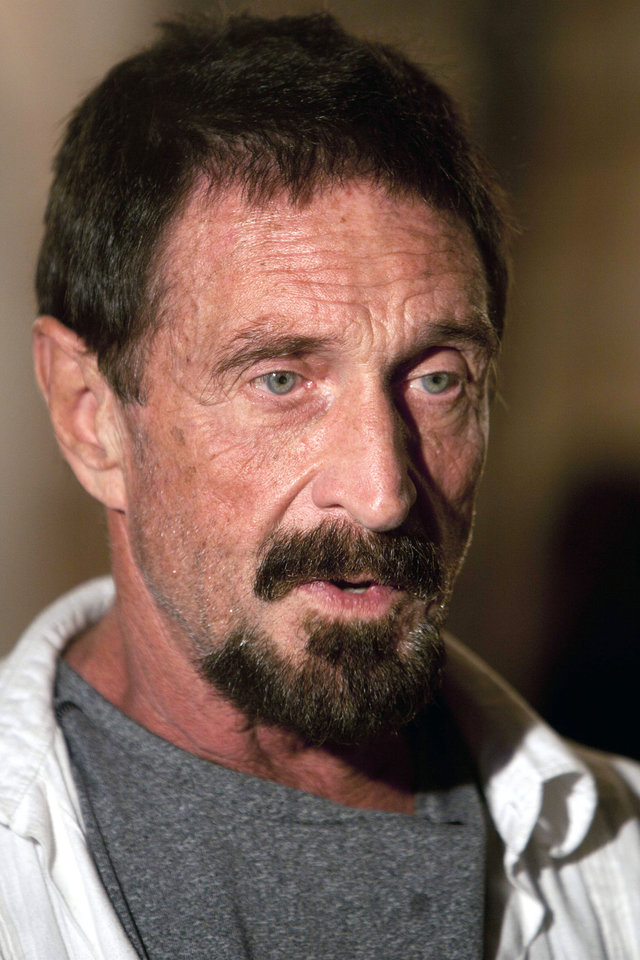 Photo - Software company founder John McAfee speaks during an interview at a local restaurant in Guatemala City, Tuesday, Dec. 4, 2012.  McAfee, 67, has been identified as a