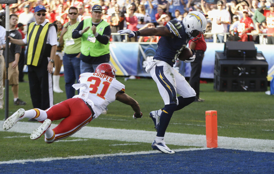 San Diego Chargers wide receiver Eddie Royal, right, gets into the end zone for a touchdown as Kansas City Chiefs cornerback Marcus Cooper defends during the second half of an NFL football game, Sunday, Dec. 29, 2013, in San Diego. (AP Photo/Lenny Ignelzi)