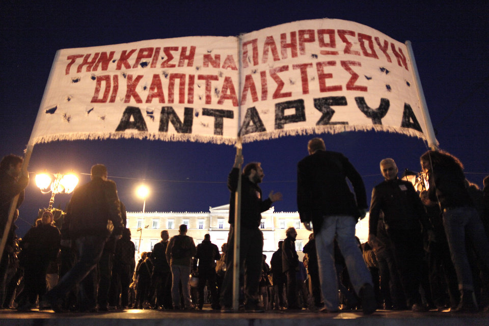 Demonstrators hold a banner reading
