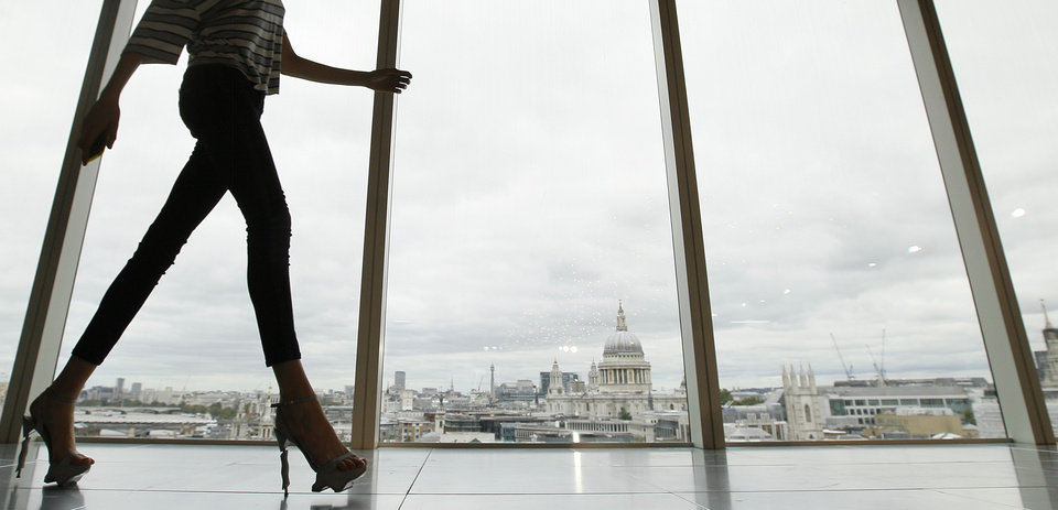 Photo -   A model walks past a window with a view of St Paul's Cathedral during the presentation of the Matthew Williamson Spring/Summer 2013 collection at London Fashion Week, Sunday, Sept. 16, 2012. (AP Photo/Alastair Grant)