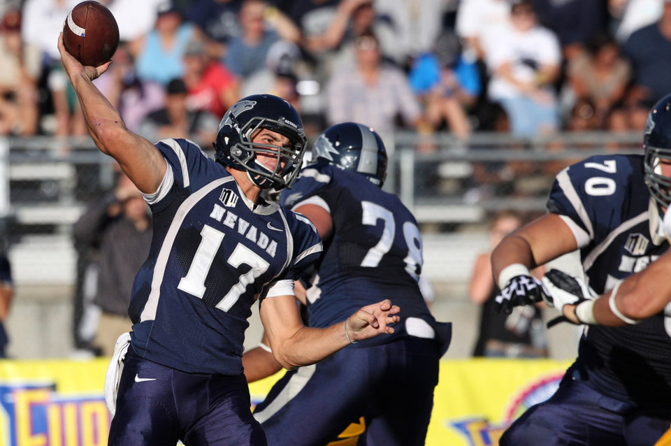 Photo -   Nevada's Cody Fajardo (17) throws a pass against Wyoming during the first half of an NCAA college football game in Reno, Nev., on Saturday, Oct. 6, 2012. (AP Photo/Cathleen Allison)