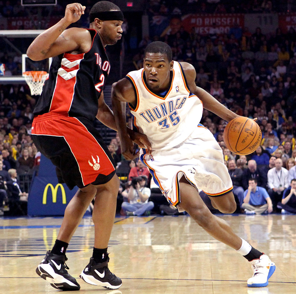Photo - Oklahoma City's Kevin Durant dribbles past pressure from Toronto's Antoine Wright during their NBA basketball game at the Ford Center in Oklahoma City on Sunday, Feb. 28, 2010. Photo by John Clanton, The Oklahoman