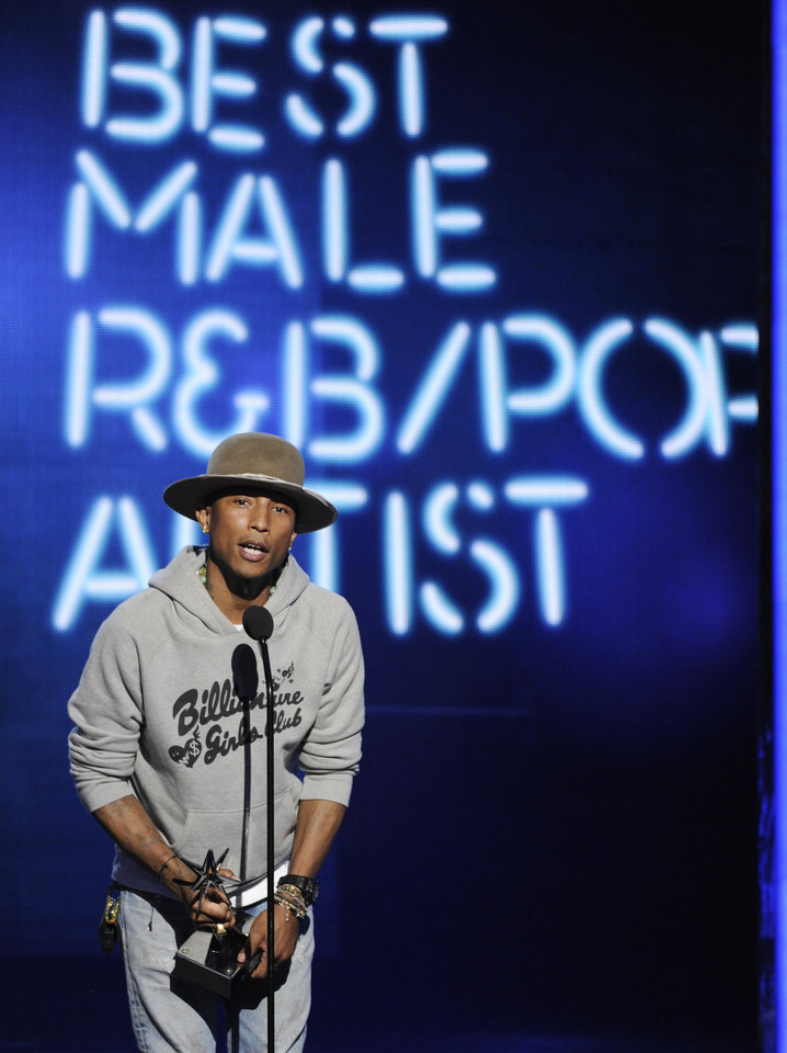 Photo - Pharrell Williams accepts the awards for best male R&B/Pop artist at the BET Awards at the Nokia Theatre on Sunday, June 29, 2014, in Los Angeles. (Photo by Chris Pizzello/Invision/AP)