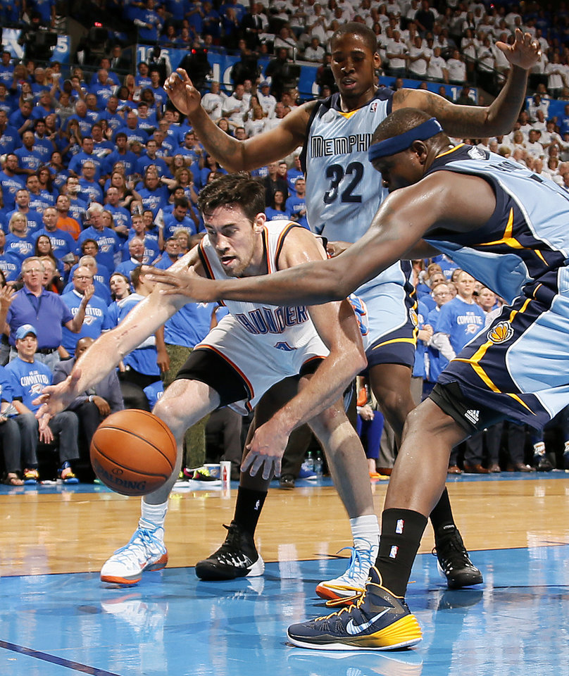 Photo - Oklahoma City's Nick Collison (4) reaches for the ball in front of Memphis' Ed Davis (32) and Zach Randolph (50) during Game 2 in the first round of the NBA playoffs between the Oklahoma City Thunder and the Memphis Grizzlies at Chesapeake Energy Arena in Oklahoma City, Monday, April 21, 2014. Photo by Nate Billings, The Oklahoman