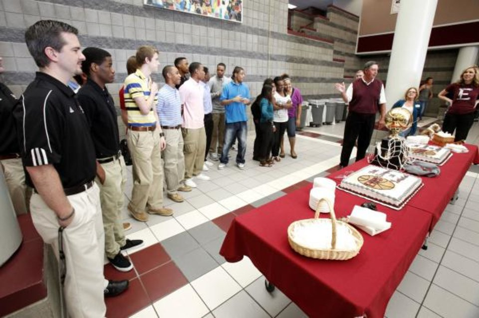 Basketball coach Shane Cowherd (left) and his team listen to Athletic Director Mike DeLagarza, as the Edmond Memorial boys basketball team celebrates their State Championship during a ceremony at Edmond Memorial High School in Edmond, OK, Friday, March 25, 2011. By Paul Hellstern, The Oklahoman <strong>PAUL HELLSTERN</strong>