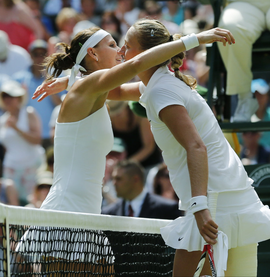 Photo - Lucie Safarova of Czech Republic, left, and Petra Kvitova of Czech Republic hug each others after their women's singles semifinal match at the All England Lawn Tennis Championships in Wimbledon, London, Thursday, July 3, 2014. Kvitova defeated Safarova in two sets. (AP Photo/Ben Curtis)
