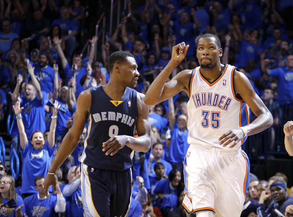 Photo - Oklahoma City 's Kevin Durant (35) celebrates a 3-point basket in front of Memphis' Tony Allen (9) during Game 1 in the first round of the NBA playoffs between the Oklahoma City Thunder and the Memphis Grizzlies at Chesapeake Energy Arena in Oklahoma City, Saturday, April 19, 2014. Photo by Sarah Phipps, The Oklahoman